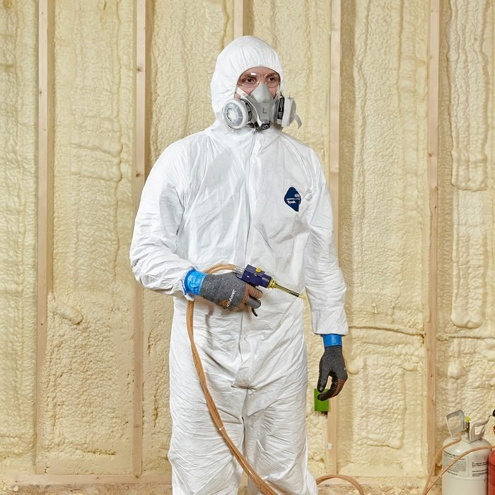 Man wearing proper spray-foaming gear | Construction Pro Tips