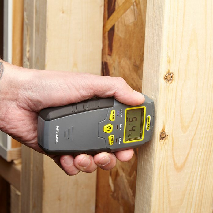 Poking wood with a moisture meter   Construction Pro Tips