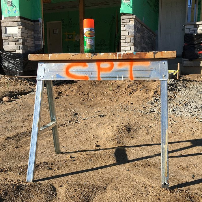 A sawhorse marked with CPT in spraypaint   Construction Pro Tips