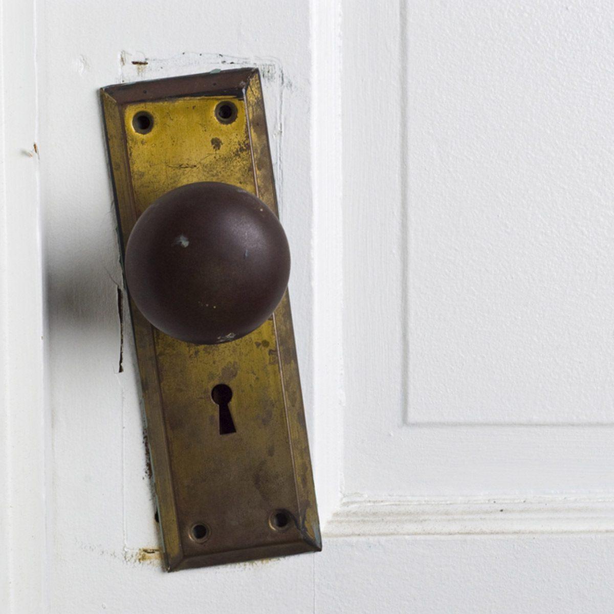 shutterstock_10664512 loose door knob home repair fix it