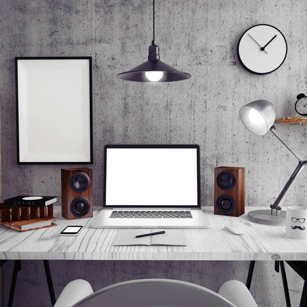 concrete basement office modern laptop computer speakers
