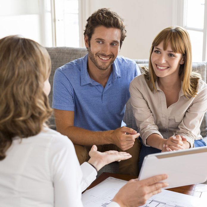 shutterstock_326432795 man and women talking with a realtor home inspector financial advice contractor research