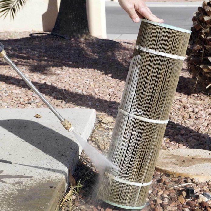 pressure washer sprays clean pool filter