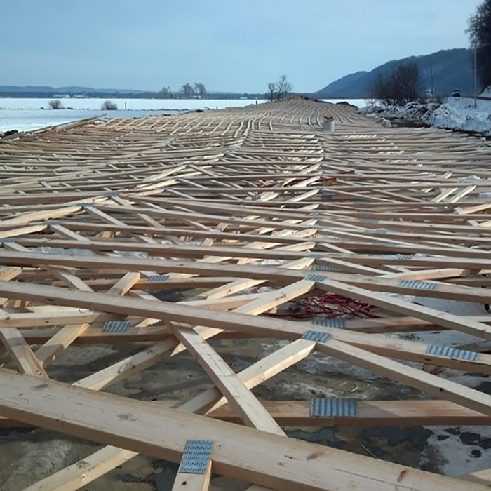 Piles and piles of collapsed trusses | Construction Pro Tips