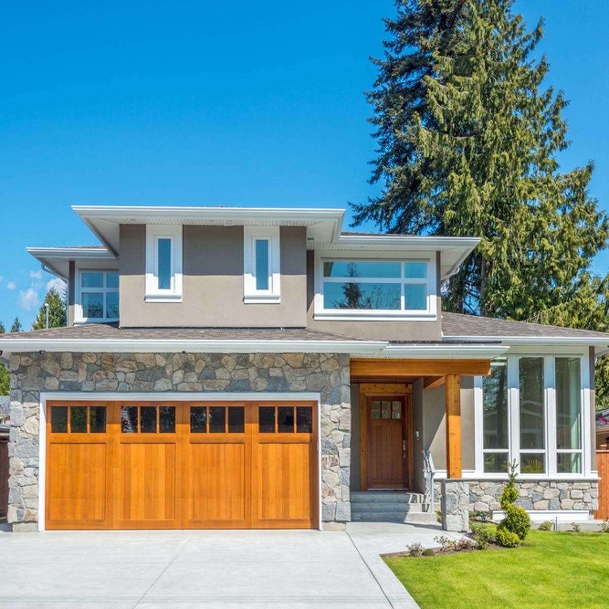 home exterior with wooden garage doors