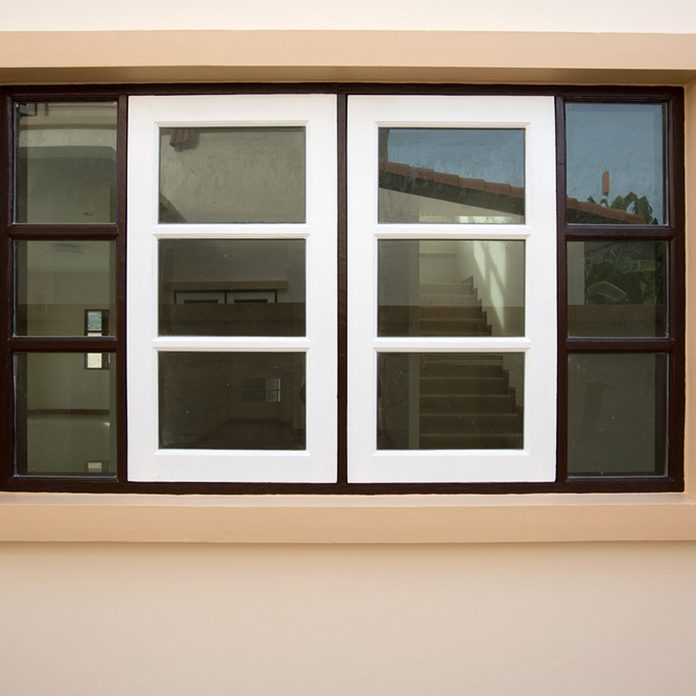 peaches and cream exterior color window with black shutters
