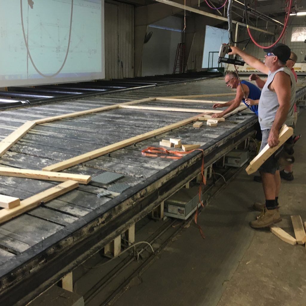 Men working the truss assembly line | Construction Pro TIps