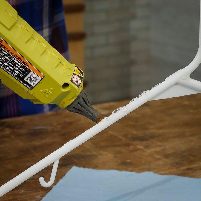 bead of hot glue on hanger