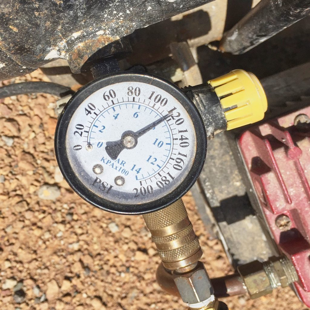 Adjustable pressure gauge on a compressor | Construction Pro Tips