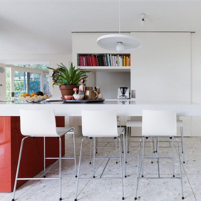 dfh11_shutterstock_487512814 terrazzo stone chip flooring white kitchen table