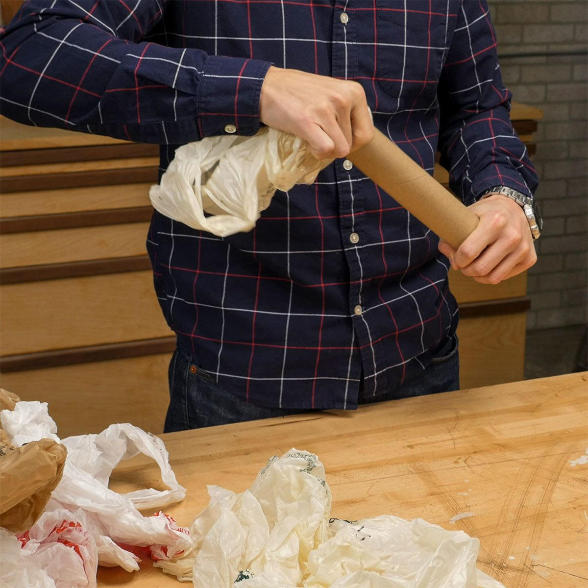 stuffing plastic bags in paper towel roll