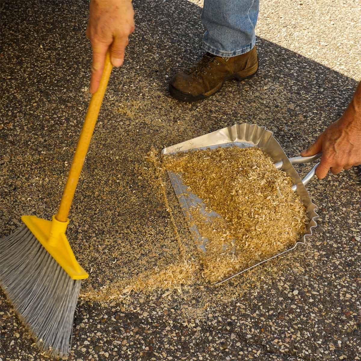 sweeping up oil-soaked sawdust