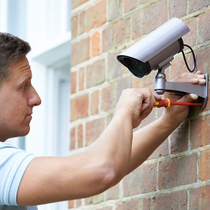 shutterstock_288541091 installing wifi security camera outdoors exterior