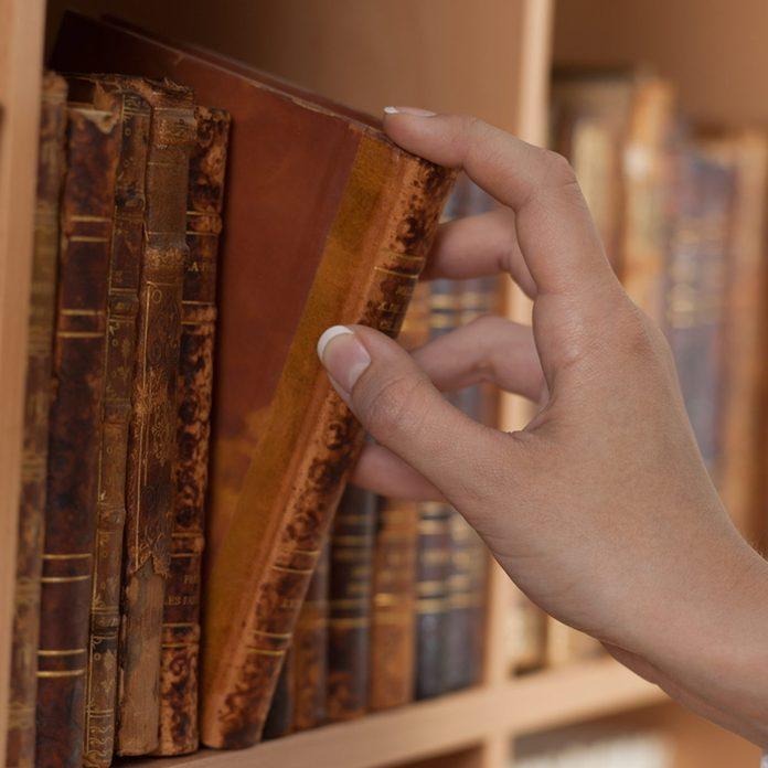 shutterstock_54512773 hidden bookcase secret opening old books