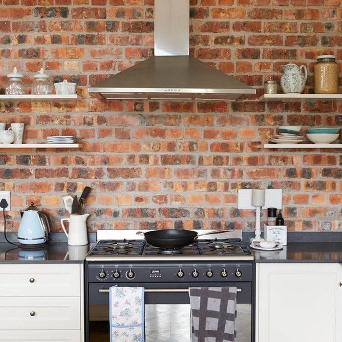 shutterstock_627683693 brick kitchen backsplash open shelves
