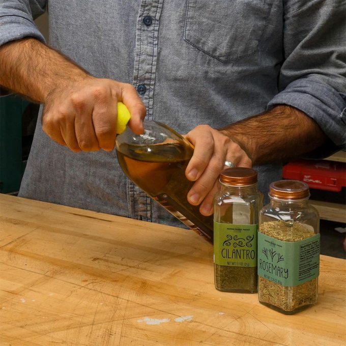 tennis ball opening olive oil bottle