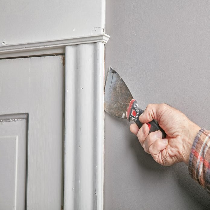 using a putty knife to separate the knife from the wall
