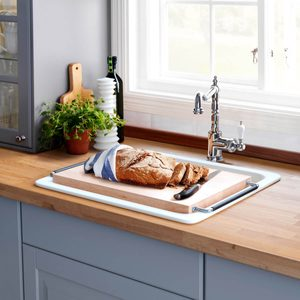 0496410_ph122283_s5 cutting board over kitchen sink
