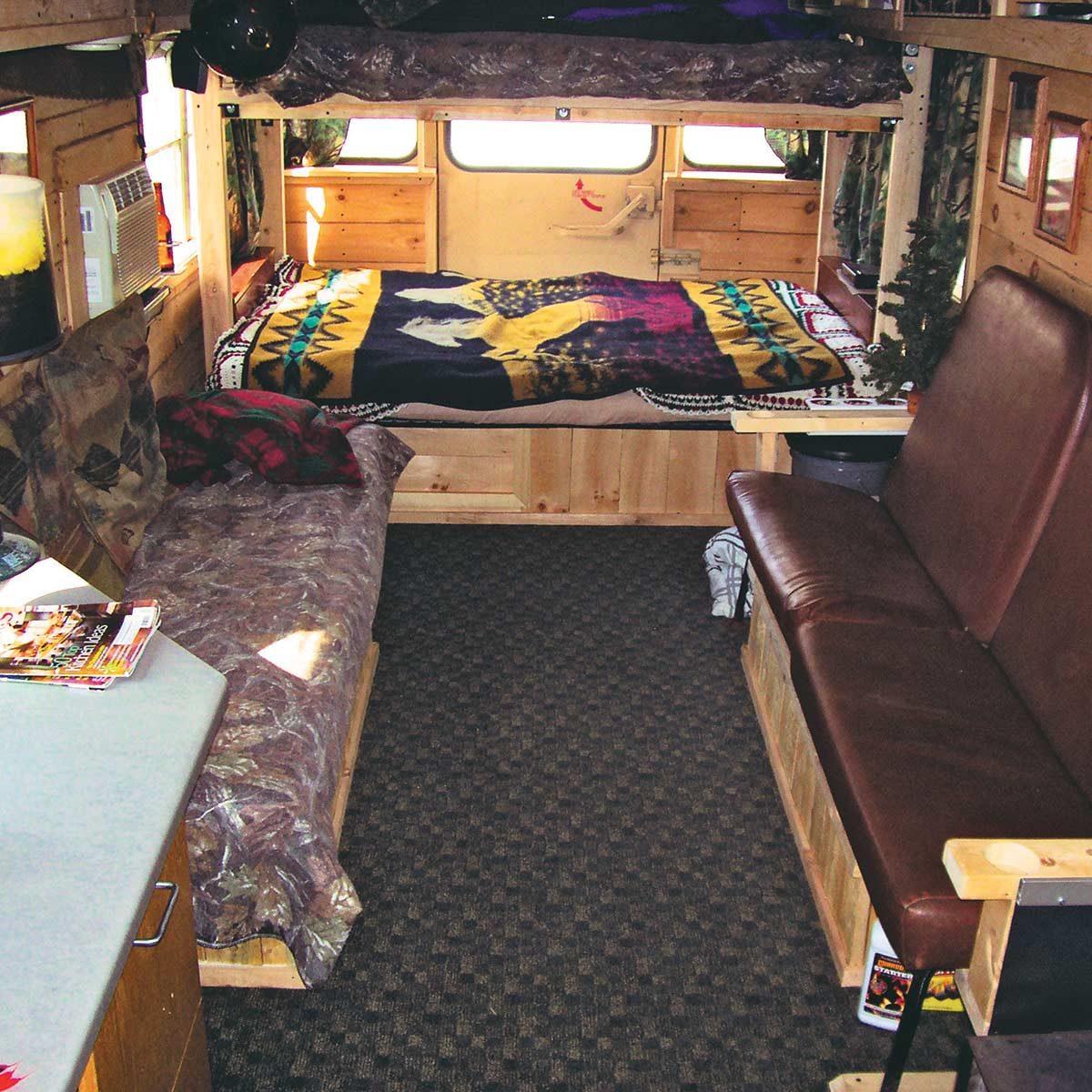 Inside of school bus turned into cabin