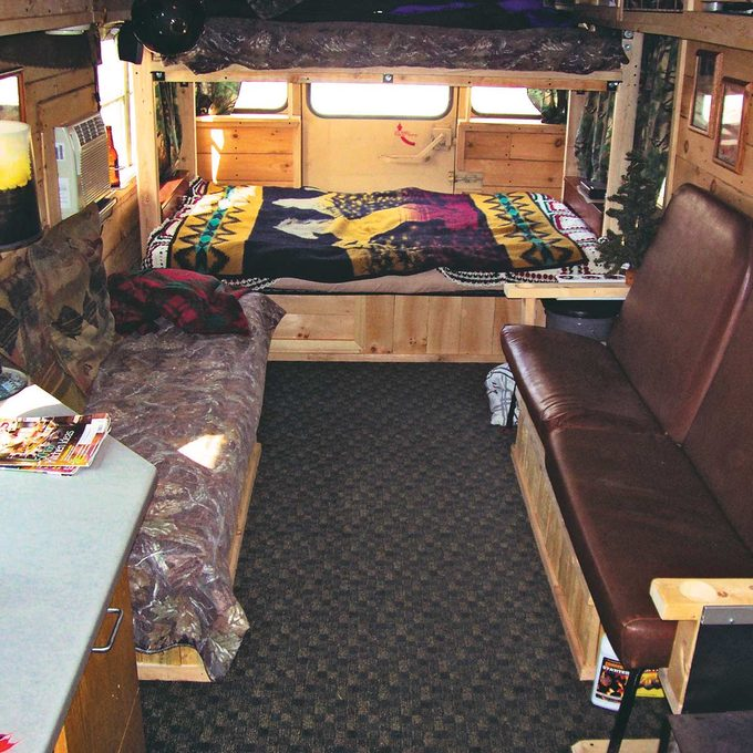 Inside of school bus turned into cabin