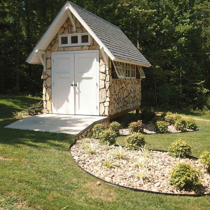 The Family Handyman garden shed with stone veneer