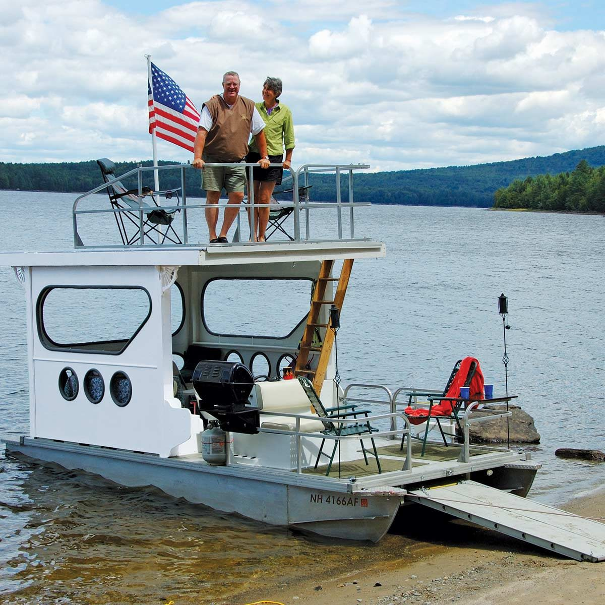 Rebuilt pontoon with covered deck and grill