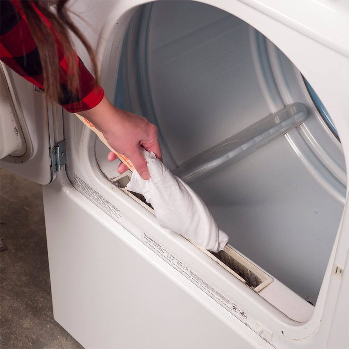 HH cleaning around lint trap on dryer