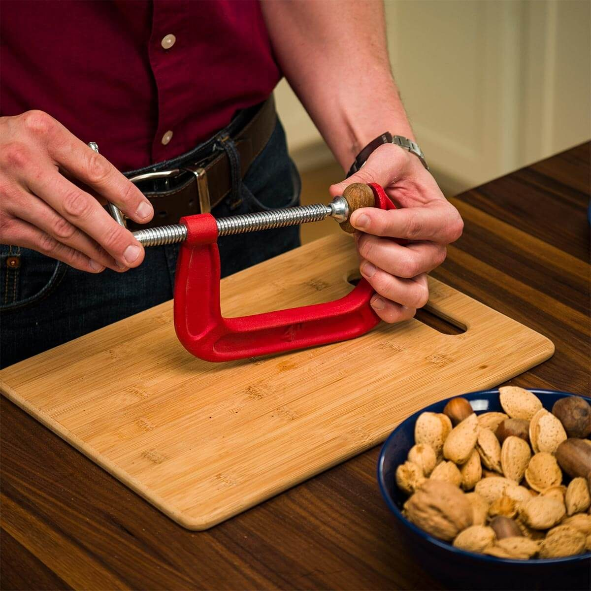 crack nuts with a C-clamp
