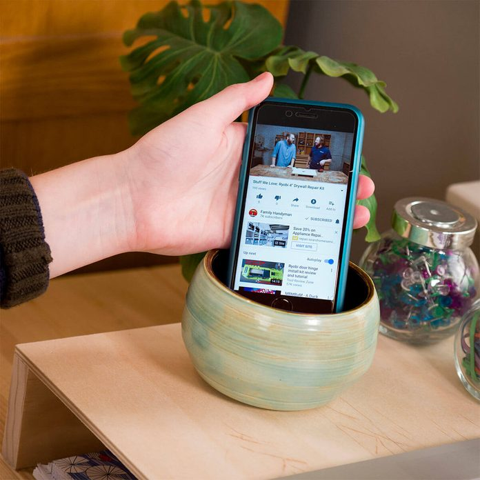 placing smartphone in pottery