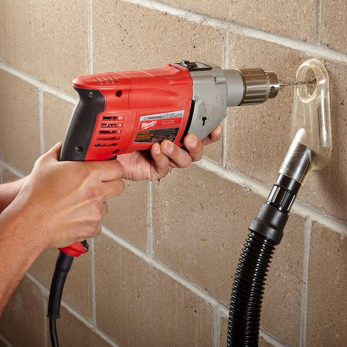 Drilling with a tool designed to immediately suck up dust   Construction Pro Tips