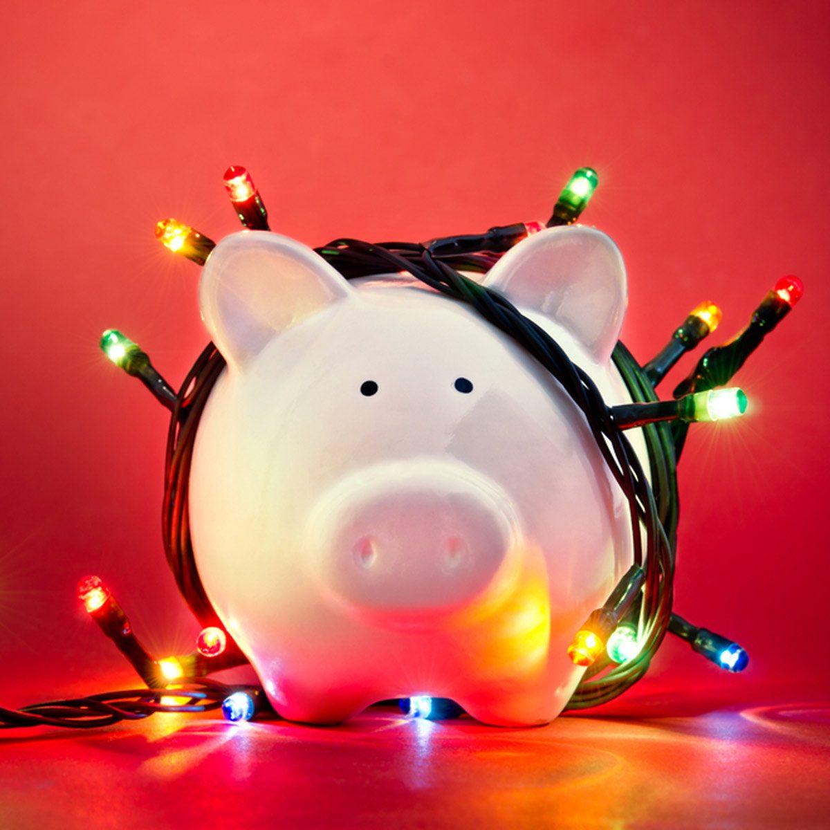 cost_158734355_01 led christmas lights saving money piggy bank money