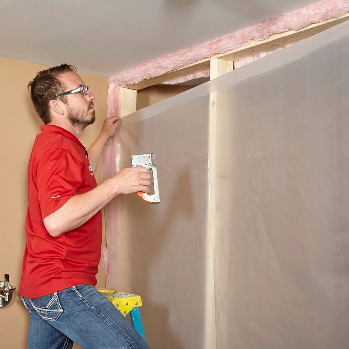 Covering a wall with plastic poly