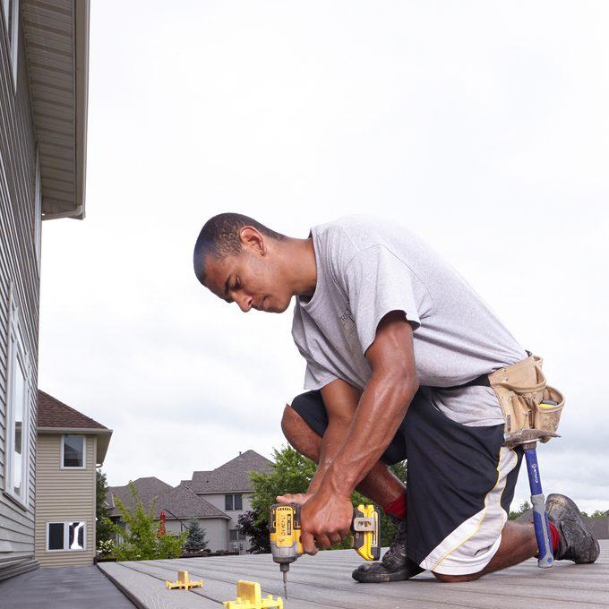 Man installing decking | Construction Pro Tips