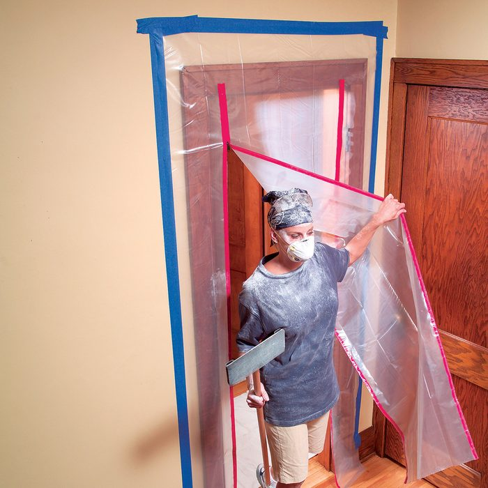 Room sealed off with poly sheets and tape   Construction Pro Tips