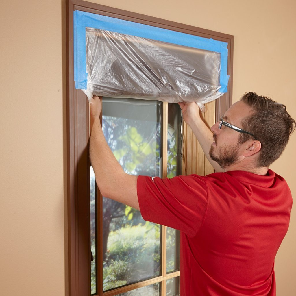 protect blinds with plastic wrap and tape