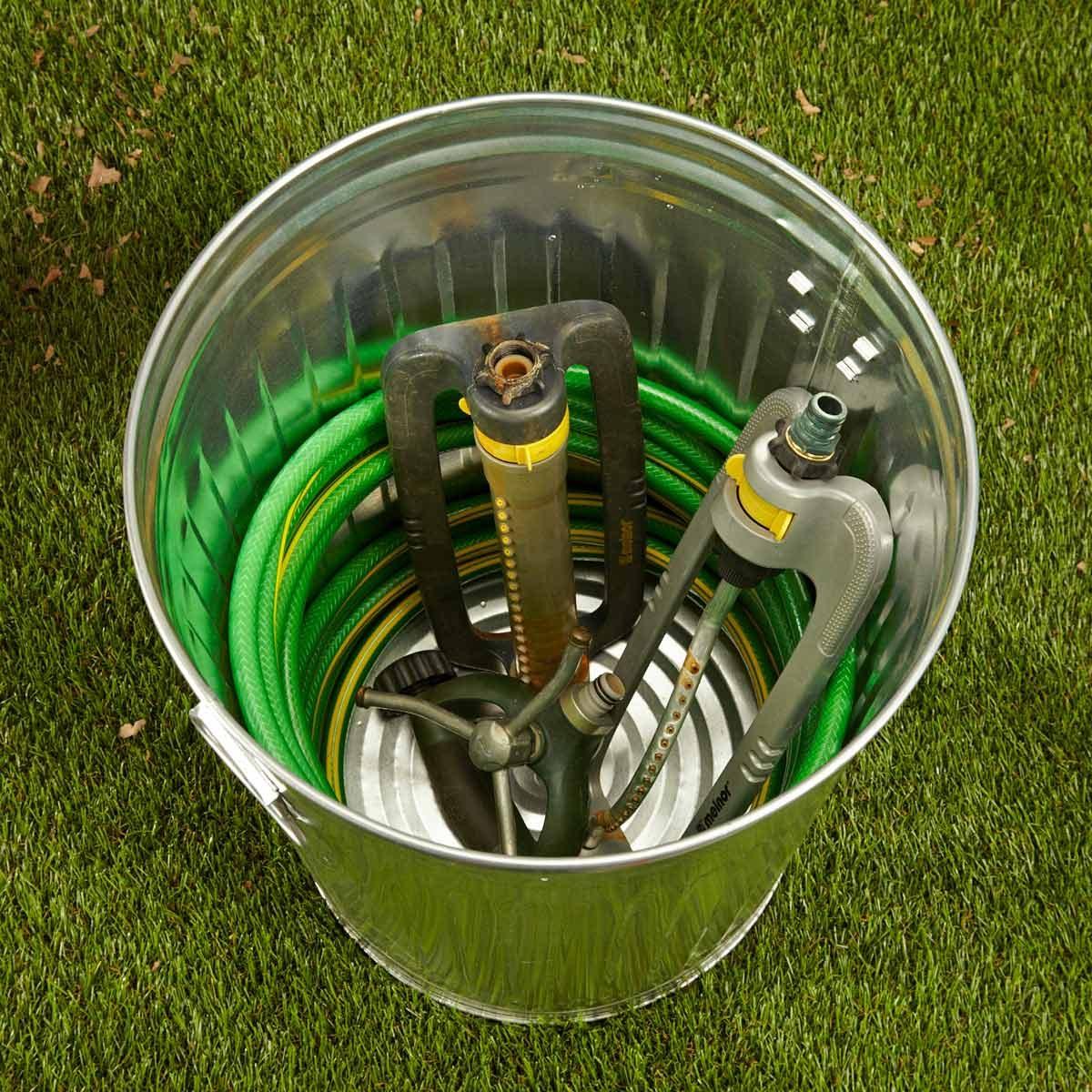 FH16APR_567_08_023 garbage can hose caddy sprinkler