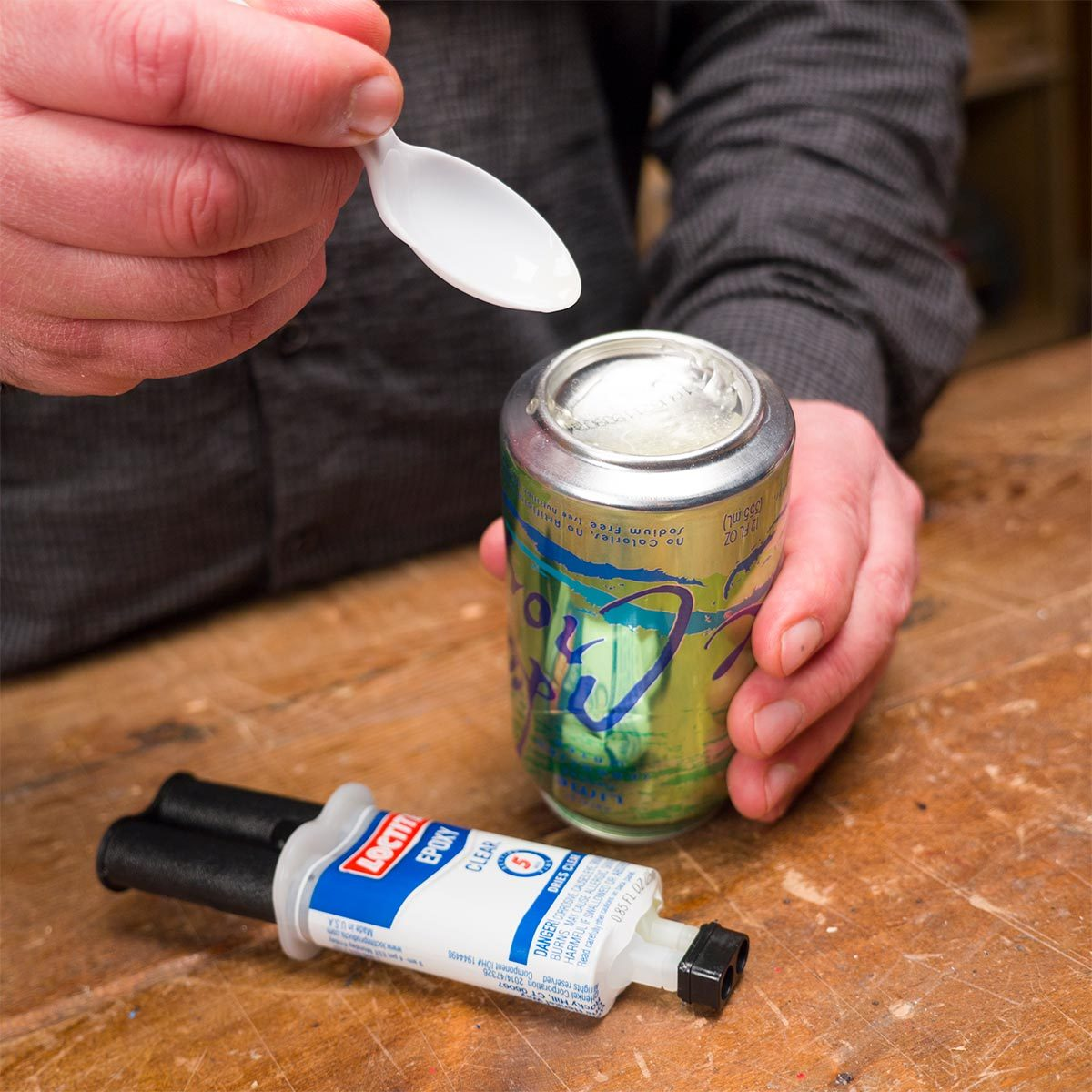 mixing epoxy on bottom of aluminum can