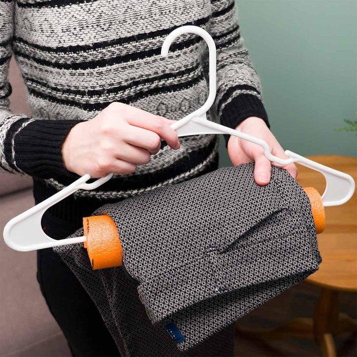 pool noodle hanger hack with dress pants laundry hack