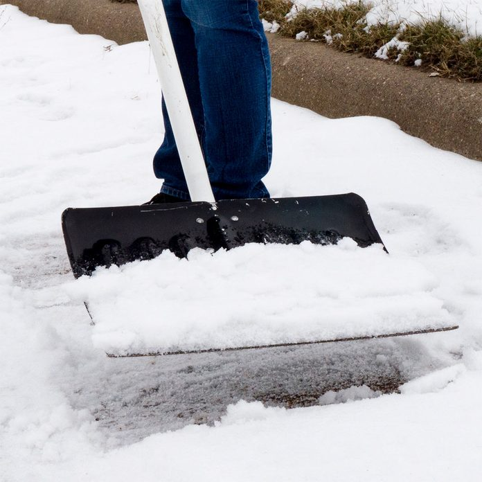 scooping snow with car wax coated snow shovel