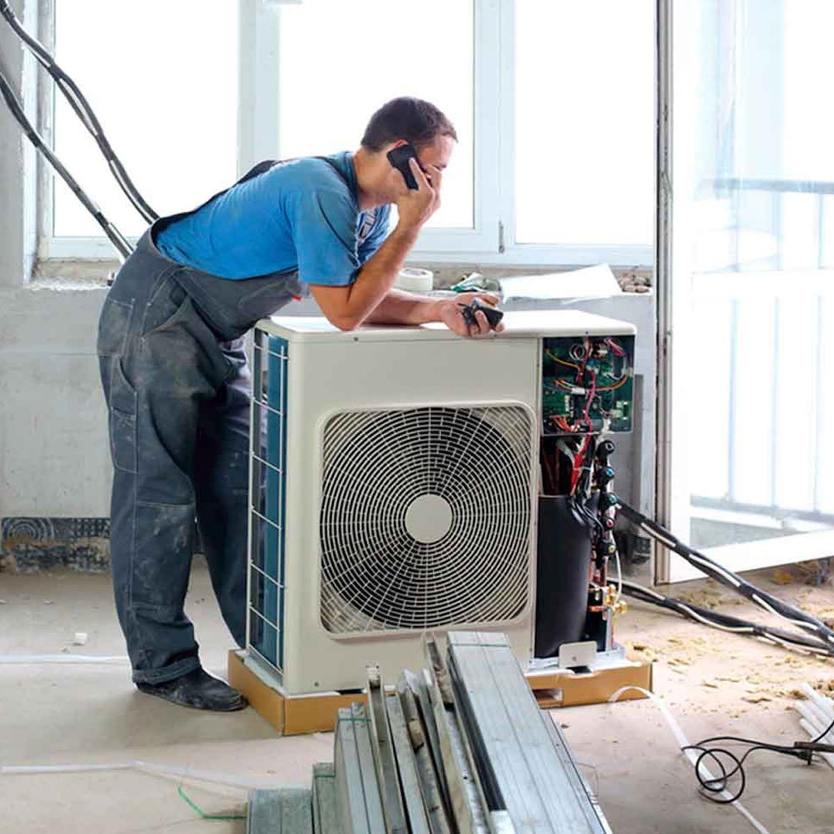 Shutterstock 159164966 air conditioner repair man hvac