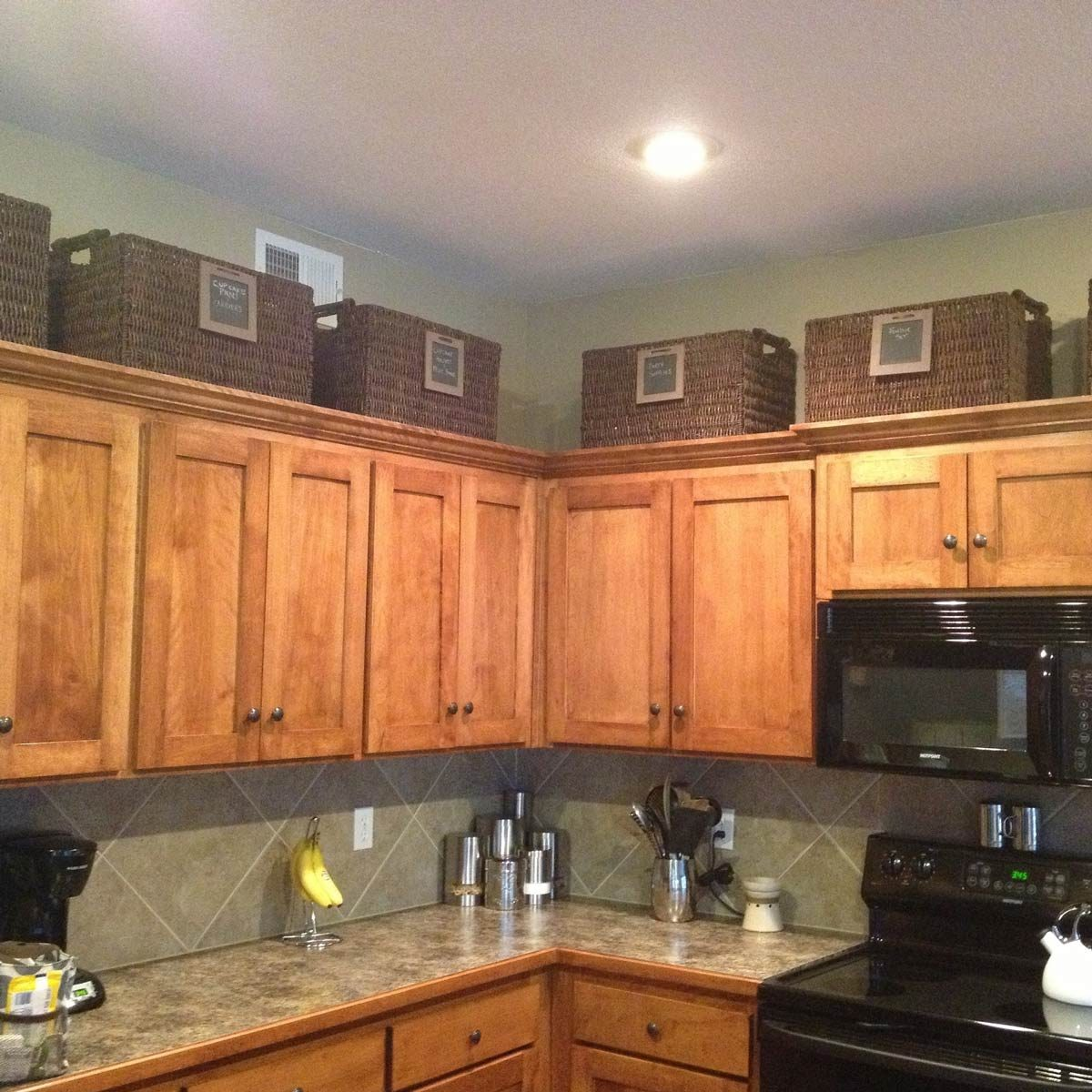 baskets-above-cupboards organizing your kitchen