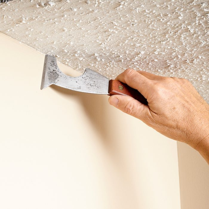 Clearing out popcorn along the ceiling line | Construction Pro Tips