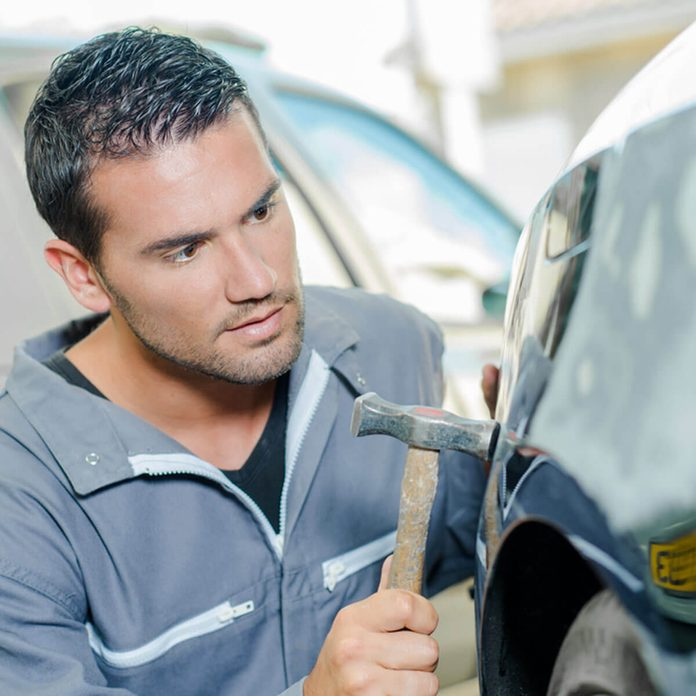 dfh8_shutterstock_277723364 auto mechanic fix car dents