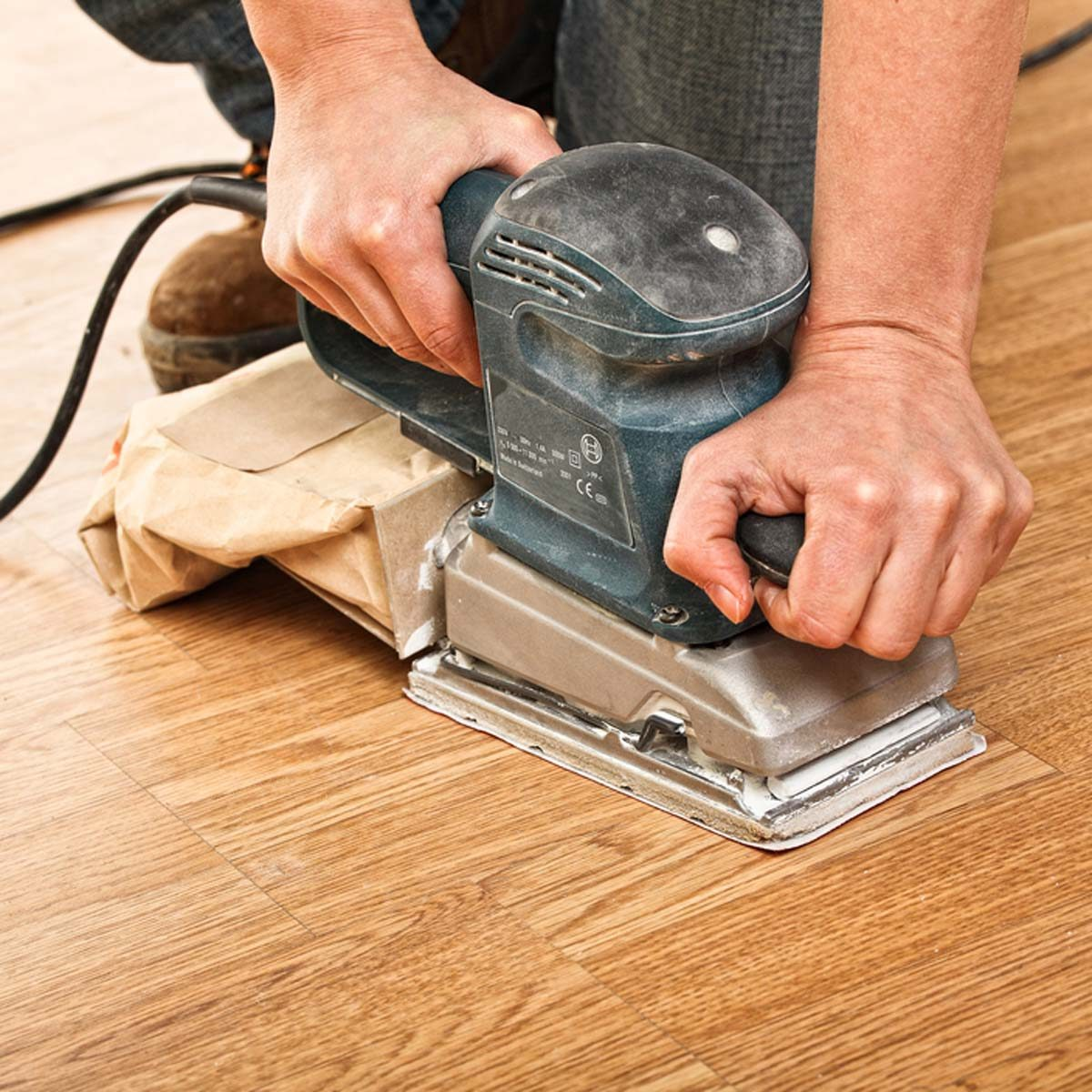 dfh9_shutterstock_76877482 sanding down wood floor scratches and imperfections refinishing