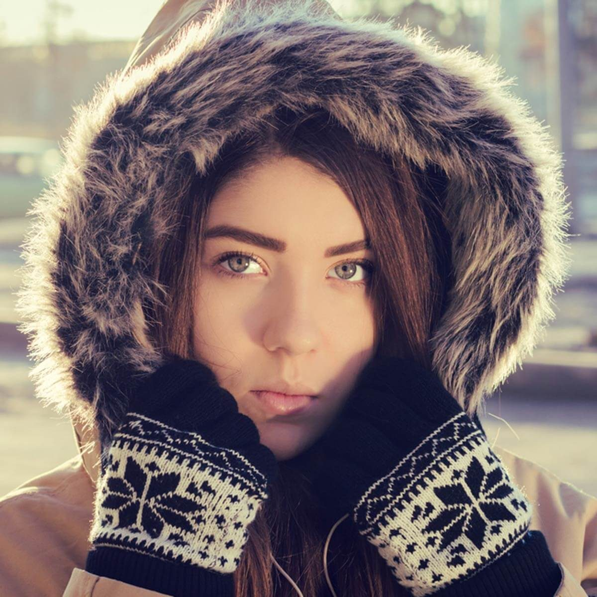 shutterstock_346216421 women in winter coat furry hood
