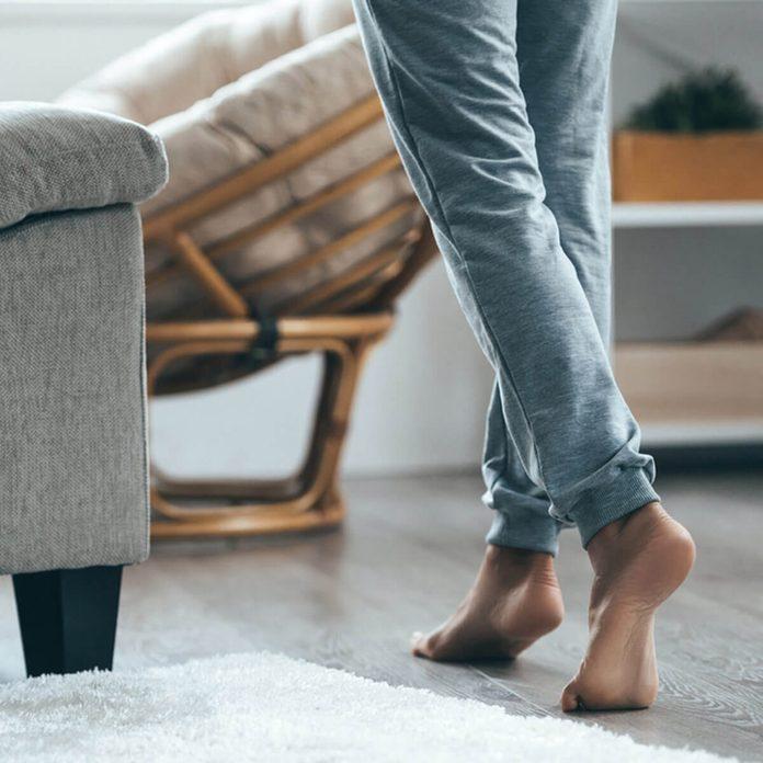 shutterstock_519670600 living room wood floors feet