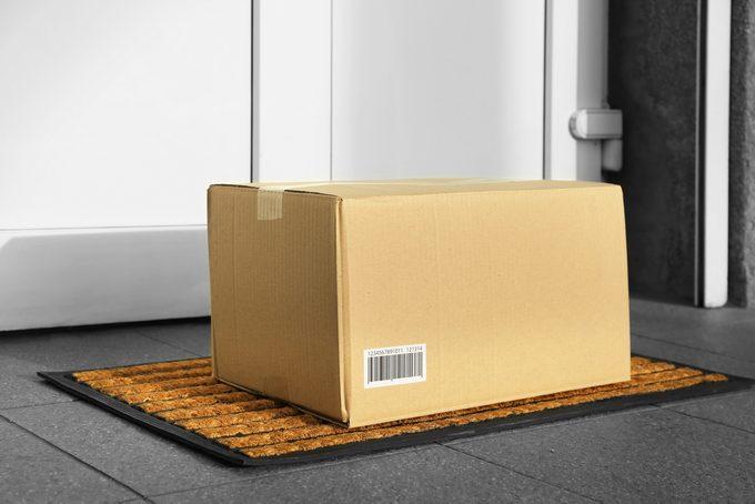 Parcel in cardboard box left on door step (it's not real QR code)