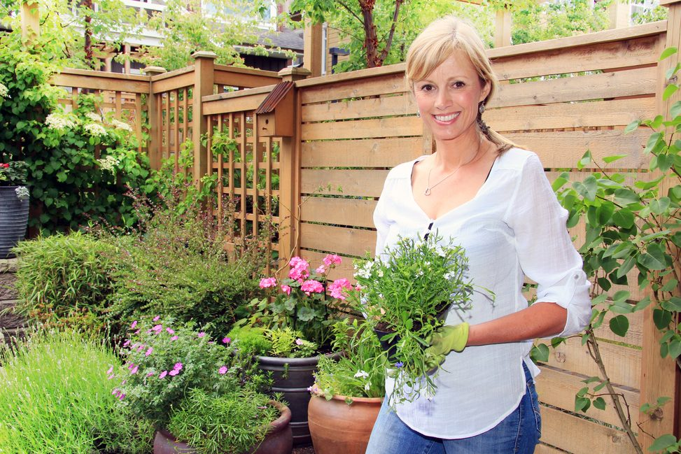 Woman outside with plants.