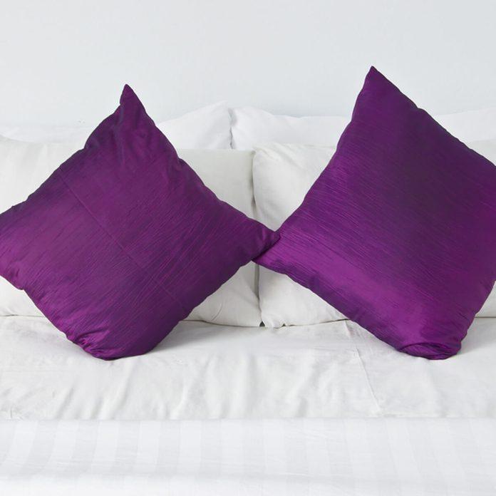 shutterstock_83025514 purple bed pillows