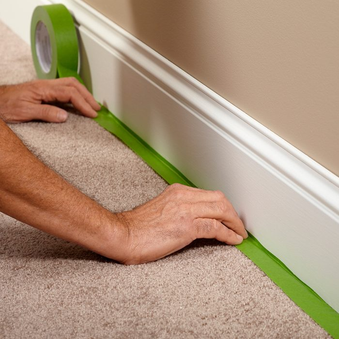 Taping off the carpet before painting | Construction Pro Tips